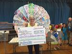 Money raised by the students presented to Christine Menard, Executive Director of The Family Pantry of Cape Cod.